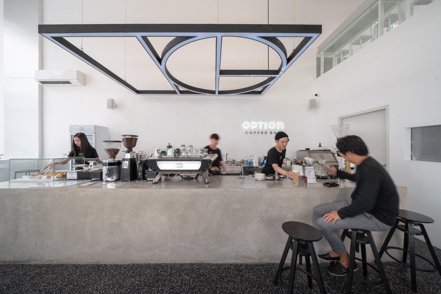 thiết kế quán cafe tối giản tone trắng